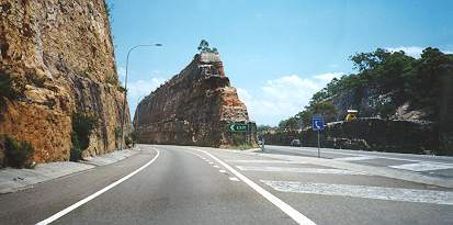 Australian way to build a highway (just cut through the mountains)